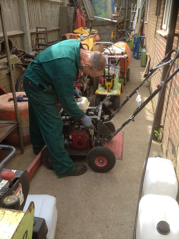 Keith working on a lawn spiker/corer, aerates the lawn, ideal on compacted grass areas and for improving drainage.